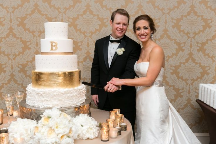 Elegant New Orleans Wedding at The Roosevelt, LA  This classic gold and white tiered wedding cake is beautiful!   Photographer:  Arte De Vie