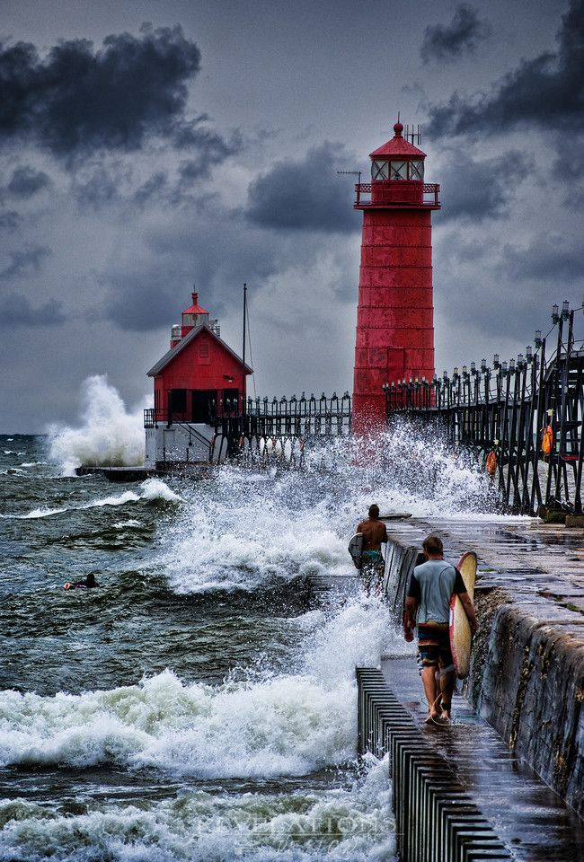 Michigan - Robert Resnick: Grand Haven Lighthouse. It's the only one like it. Notice idiots on pier.