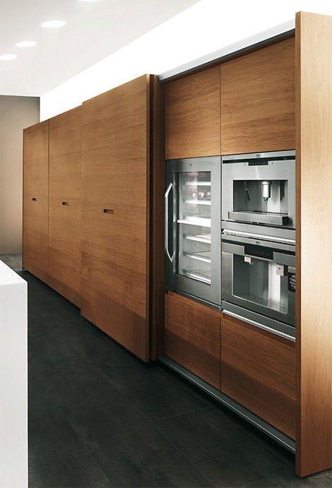 Wood Kitchen slide doors hidden appliances barefootstyling.com