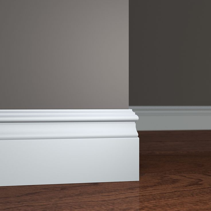 installing baseboard molding on grey wall and wooden floor ideas