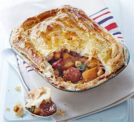 These individual pies are quick to prepare, packed with spicy sausage and butternut squash, then topped with a ready-rolled puff pastry lid
