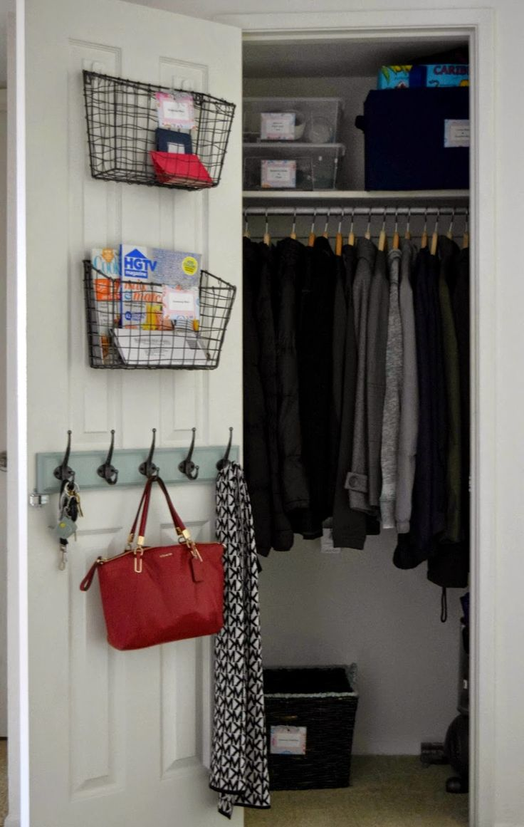 I'm so doing this in my coat closet! Wire basket & hooks are an AWESOME way to utilize closet door space!