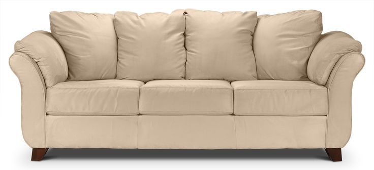 A Flair to Remember. With its distinctive profile, the Collier sofa will be at home in any well-designed room. The combination of flared arms and legs give this piece a unique silhouette, and the soothing beige microfibre is smooth and luxurious. Overstuffed cushions, padded arms and no-sag springs serve as a perfect path to comfort. Made in Canada.