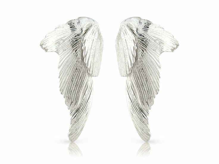 Svan earrings big - Svanur or The Swan is an idea born in one of these vacations. Guðbjörg watched these majestic birds and admired the contradictions in them. #Jewellery #Design #Icelandic #Iceland #Aurum