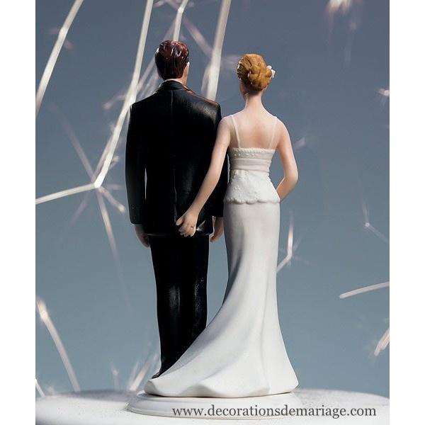 La figurine de mariage pincée d