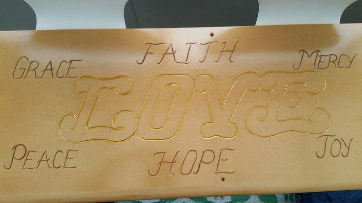 Scripture words carved