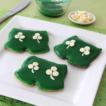 Decorate Mickey's Shamrock Shorts Cookies with white chocolate shamrock buttons, and these festive cookies are a perfect fit for a St. Patrick's Day party or classroom treat. | [ http://family.disney.com/recipe/mickeys-shamrock-shorts-cookies ]