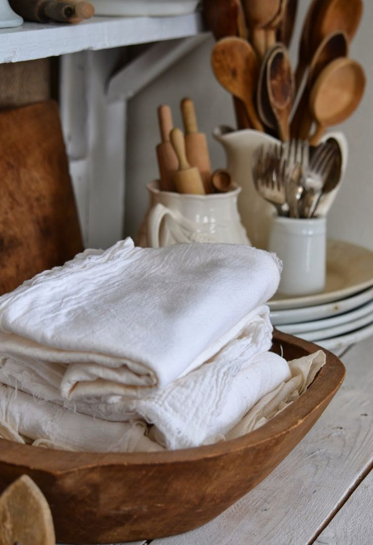 stacks of flour sack towels, wooden spoons, and ironstone in the farm house kitchen