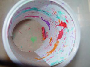 shake and paint - toddler painting without making a mess using a large empty oatmeal container with a piece of white paper taped inside. Dip broken crayons in a small amount of kids paint. Put them inside the container and then put the lid back on. Now let your toddler take the container and shake it, roll it on the floor, kick it or whatever to move the crayons around inside.