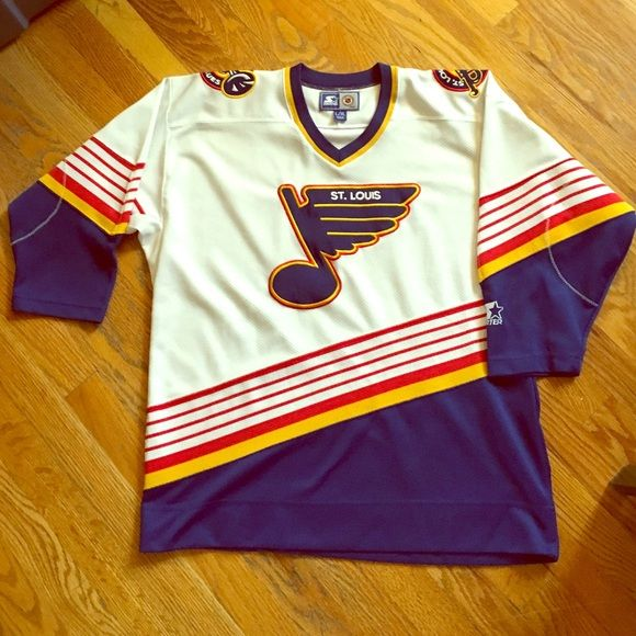 Old school St. Louis Blues NHL jersey Old school NHL jersey. White, red, blue, and gold, from the 90's. In excellent condition. Starter is brand. Size L/XL in kids. I wore it and I normally wear a women's small/med. Now I would just wear a long sleeve shirt underneath bc it comes to about a 3/4 sleeve Sweaters V-Necks