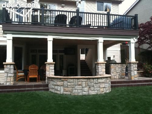 Base Stone Work On This Lower Level Patio Along With The Upper Deck Adds  Versatile And
