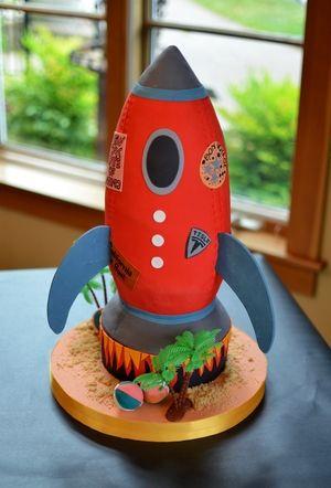 Retro rocket ship cake with edible bumper stickers. Image © Carla Niermann
