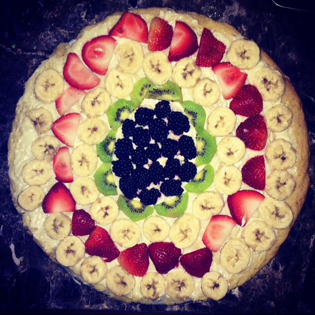 Delicious fruit pizza. Blue berries, kiwi, strawberries, and bananas all on top of a huge sugar cookie. Can you say yummy