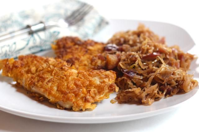 This recipe for the crunchiest chicken schnitzel ever is made with cornflakes cereal and paired with sweet and sour homemade german apple sauerkraut