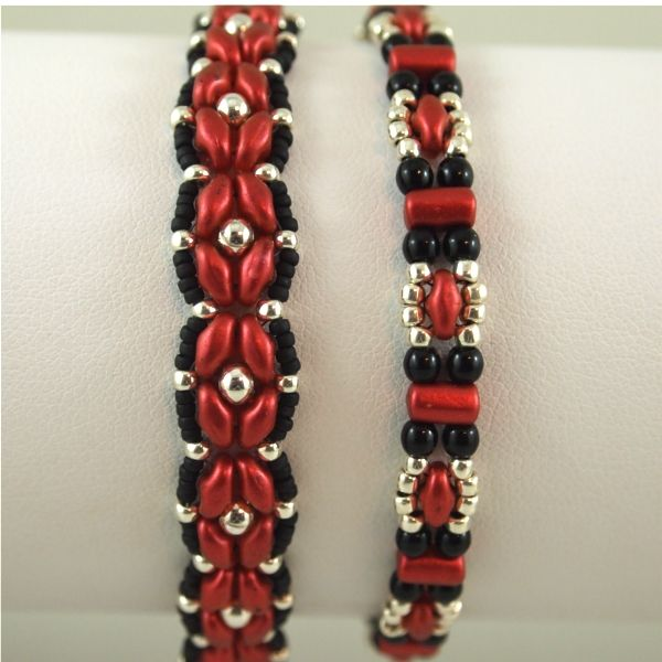 Red Lava beads with black and silver. On right is Deb Roberti's Trestle pattern. On left is sam Wescott's Rosette design. I used the same tweak for the rosette bracelet as previously used in the Toying with Tiles bracelet...anchored the side beads to the design