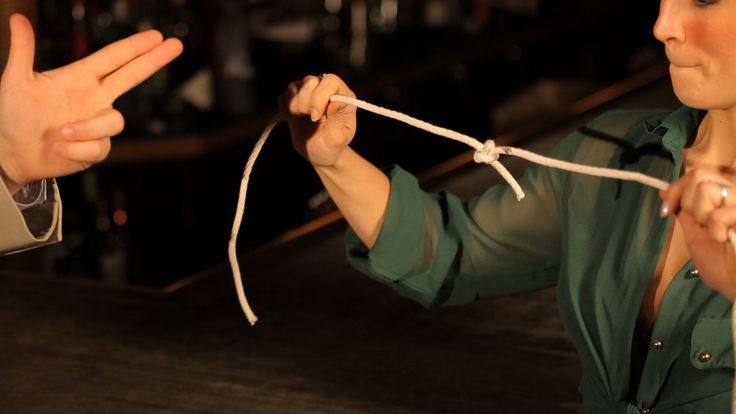 Learn how to make a knot pop off a rope in this dinner table magic tricks video from Howcast.