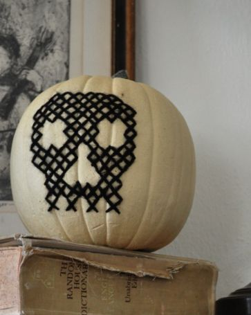 How to cross-stitch on a fake pumpkin.