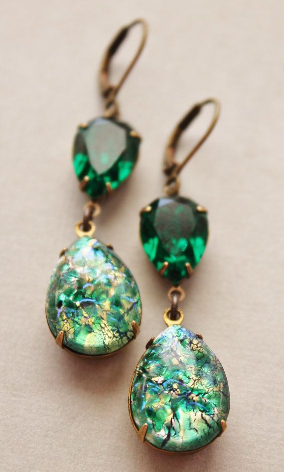 Lovely little earrings made using vintage, rare, green fire opals and genuine Swarovski elements. The opals are mand-made glass fire opals from