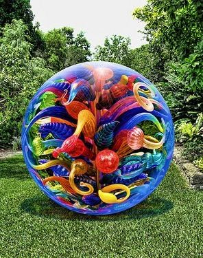 Blown glass shapes & designs inside a huge blown glass sphere