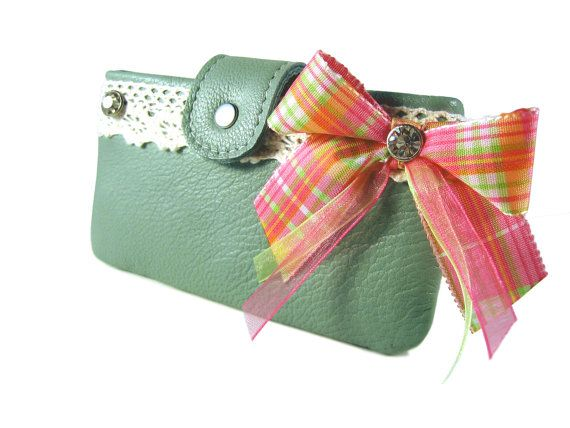 Limited Edition  Custom made smartphone bag from lime green nappa leather with cotton lace, rhinestones rivets and colorful ribbons application.  Inside, the bag has a thin...