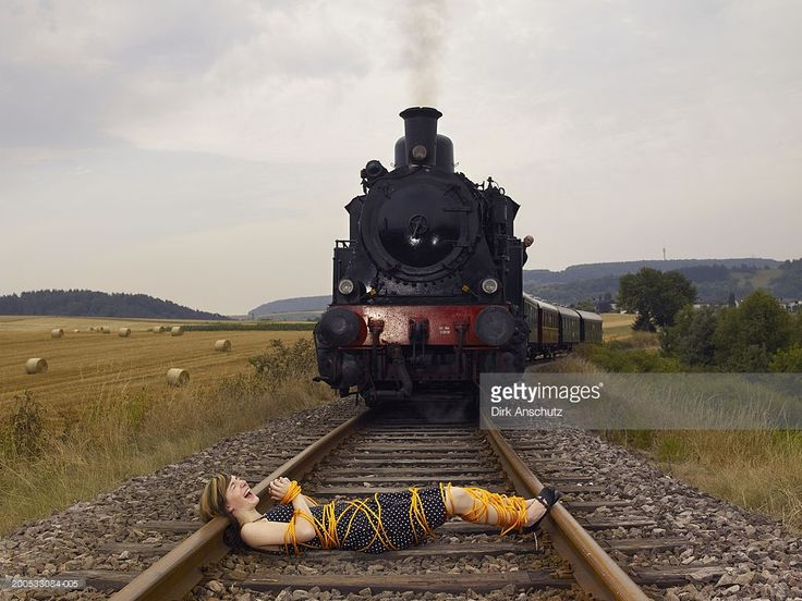 'Woman tied up in rope lying on train track in front of steam train, screaming'