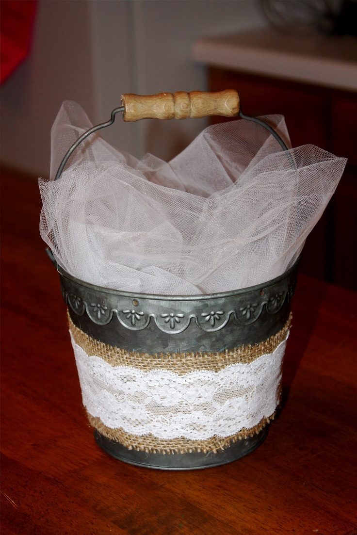 Use an old pail, wrap it in burlap and then lace for the flower girl basket