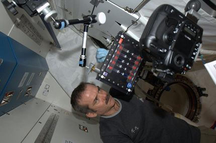 Chris Hadfield mixing colloids in a test tube