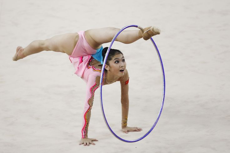 China's Liu Jiahui performs with the hoop in the individual rhythmic gymnastics competition at the Namdong Gymnasium Club during the 17th Asian Games