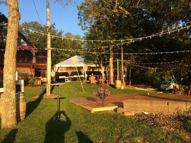 Outdoor cafe lighting draped over a dance floor lighting support outdoor cafe lighting draped over a dance floor lighting support poles are made out of whiskey barrels rent them for your next event in cincinnti mozeypictures Image collections