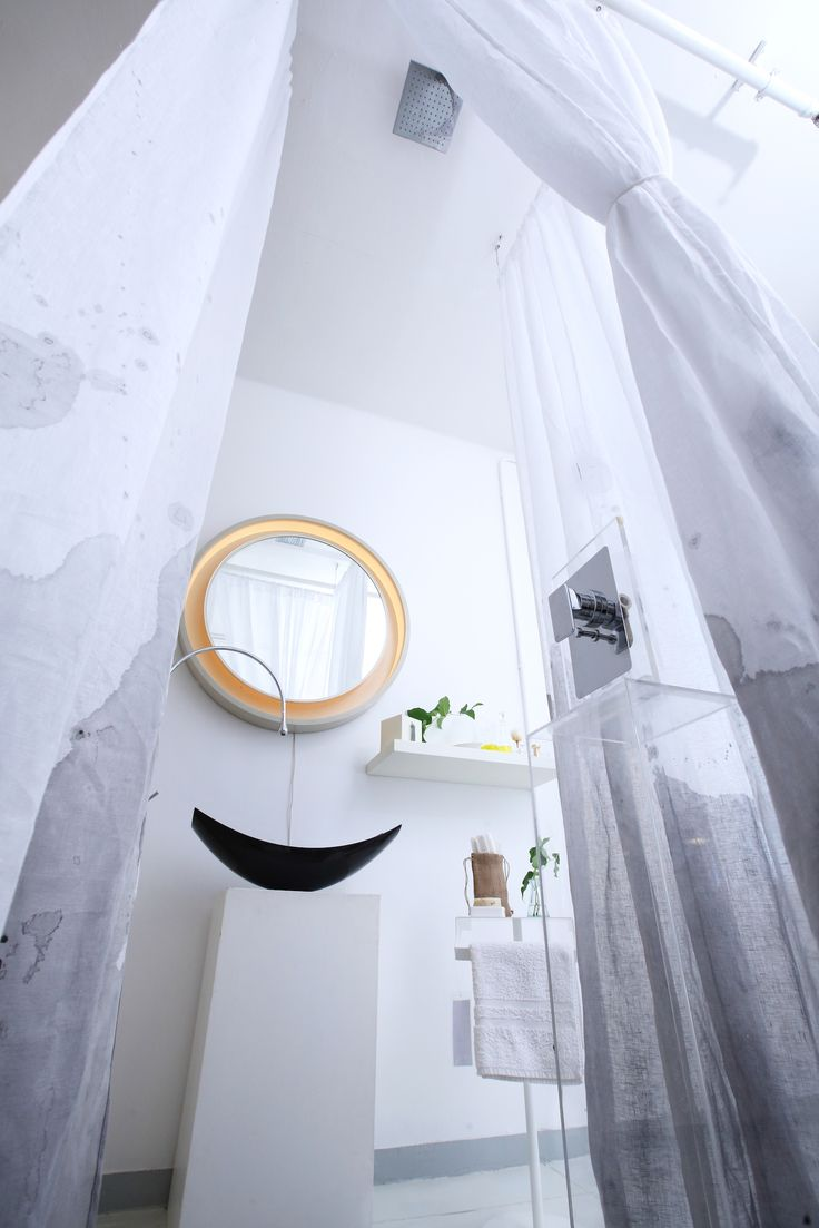 I designed the shower to be in the centre of the room. It frames the architectural basin and mixer tap and antique mirror