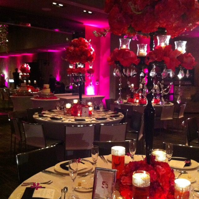 pink & black wedding...I love the crystals on the top of the vases