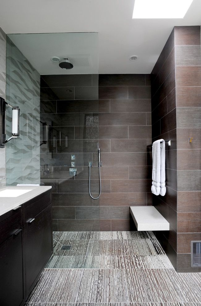 sleek bathroom with floating bench and a curbless shower floor