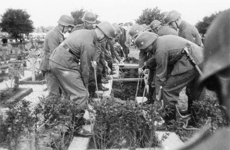 The Germans bury their dead after the Dieppe raid, August 19, 1942.