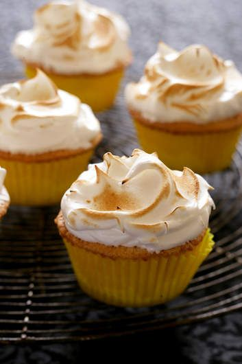 These cupcakes are light and airy with a delicate meringue topping. You will need a sugar thermometer for the meringue - don't be put off, it's really easy. If you happen to have a blowtorch, you will get a professional and impressive finish.