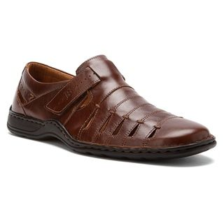European style shines through in the Josef Seibel Lionel 06 loafer. Featuring handsewn construction, this men's casual shoe has a full grain leather upper with ventilating details and an adjustable hook-and-loop strap at the instep for a custom fit. A leather lining and sockliner pull moisture away from the foot to maintain a fresh interior. The Josef Seibel Lionel 06 casual walking shoe has a flexible polyurethane sole to offer steady traction, wherever the day leads you.