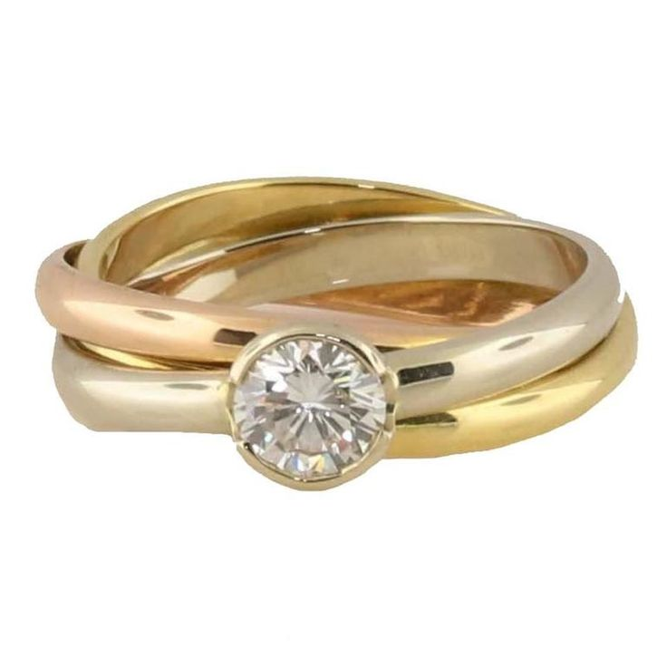 Cartier Tricolor .50 Carat Solitaire Diamond Gold Rolling Ring   From a unique collection of vintage solitaire rings at https://www.1stdibs.com/jewelry/rings/solitaire-rings/