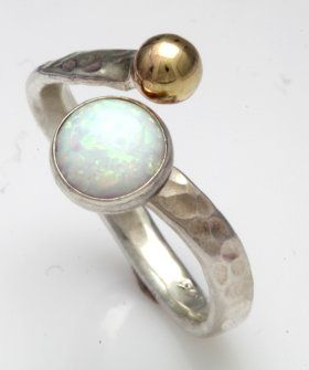 sterling silver and 9ct gold 3mm adjustable ring set with 8mm white opal