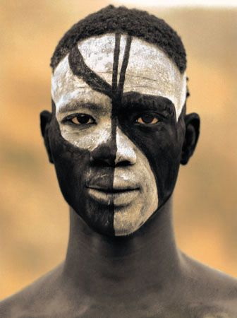 Sudan. Nuba boy photographed by Leni Riefenstahl, 1975. Traditional facepainting by South-East Nuba people of Sudan: