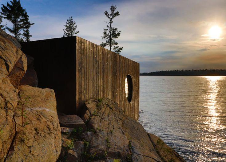 Burnt-timber exterior of sauna by Canadian studio Partisans