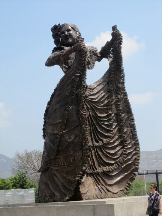 """In March 2010 Amilkar Ariza revealed his more recent work, the monumental sculpture of """"La Pilonera"""" a woman dancing the traditional dance of the north coast of Colombia (Caribbean coast) and it portraits the image of Mrs. Consuelo Araujonoguera, a former head of the Ministry of the Cultural Affairs in Colombia who was killed by the FARC guerrilla during a rescue attempt by the Colombian Army."""