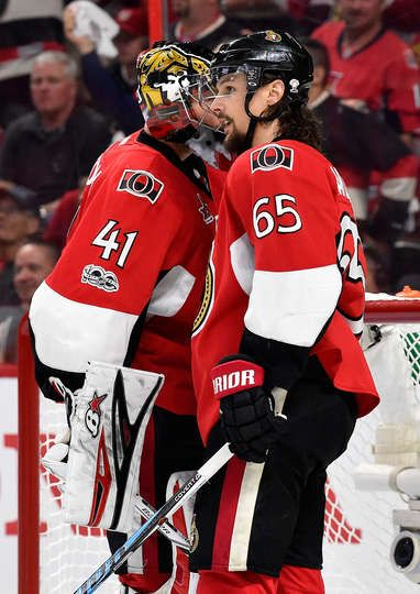 OTTAWA, ON - MAY 17: Craig Anderson #41 and Erik Karlsson #65 of the Ottawa Senators talk against the Pittsburgh Penguins during the second period in Game Three of the Eastern Conference Final during the 2017 NHL Stanley Cup Playoffs at Canadian Tire Centre on May 17, 2017 in Ottawa, Canada. (Photo by Minas Panagiotakis/Getty Images)