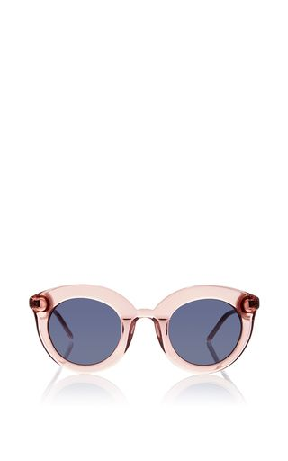 Designed and handcrafted in Norway, these shades by **Kaibosh** feature a cat eye style pink acetate front for a feminine touch.