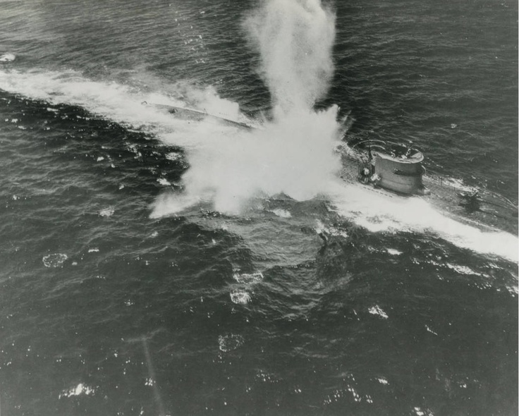 A German U-Boot (Type VII) is caught on the surface and is attacked by US carrier-based anti-sub planes. Undisclosed location, undated.