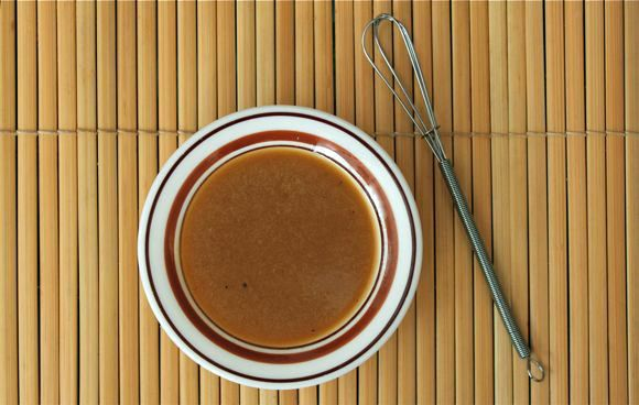 Sesame Ginger Dressing Recipe....i used olive oil instead of canola and one extra tbsp honey and then mixed it all using a submersion blender. It tastes just like Taj Okinawa's dressing!!! Ahhh, so good!