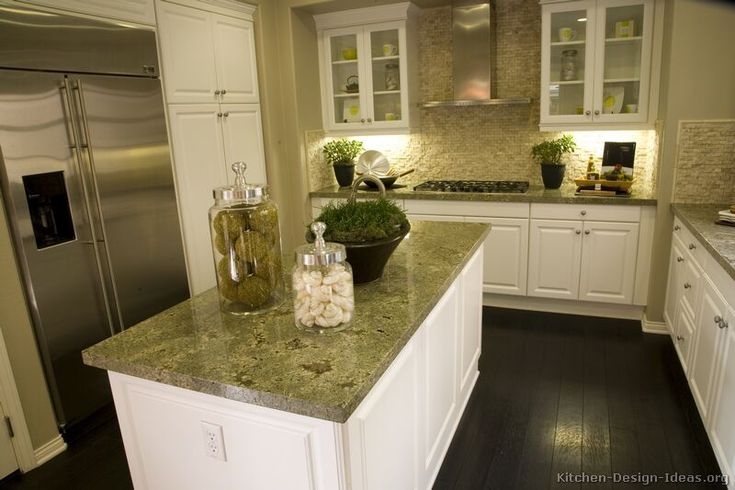Traditional White Kitchen Cabinets #60 (Kitchen-Design-Ideas.org) THIS really might be it... all except for floor. Same choco color, but herringbone tile instead. Plus a much better hood. maybe copper?