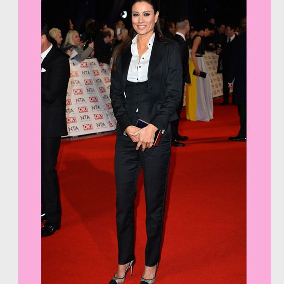 Melanie Sykes wore a shapeless black sateen trouser suit complete with ill - fitting waist cincher. She unfortunately failed to nail the masculine feminine trend we have seen frequently in past seasons. This could have been a winning look if she had picked a better fabric and chosen a tailored fit – Sorry Mel!
