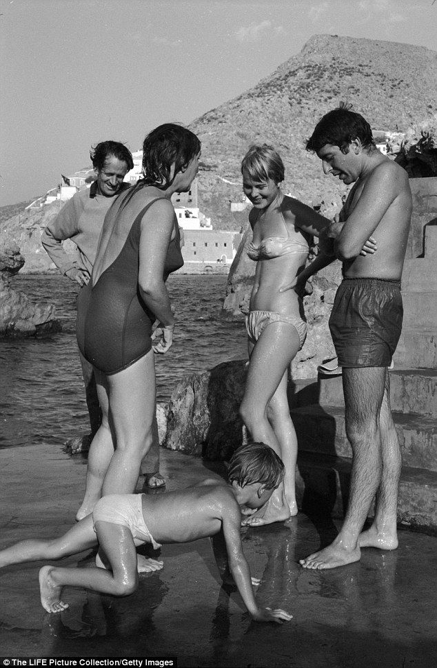 Leonard Cohen (right) is seen with Marianne Jensen (second right) in Greece in 1960...