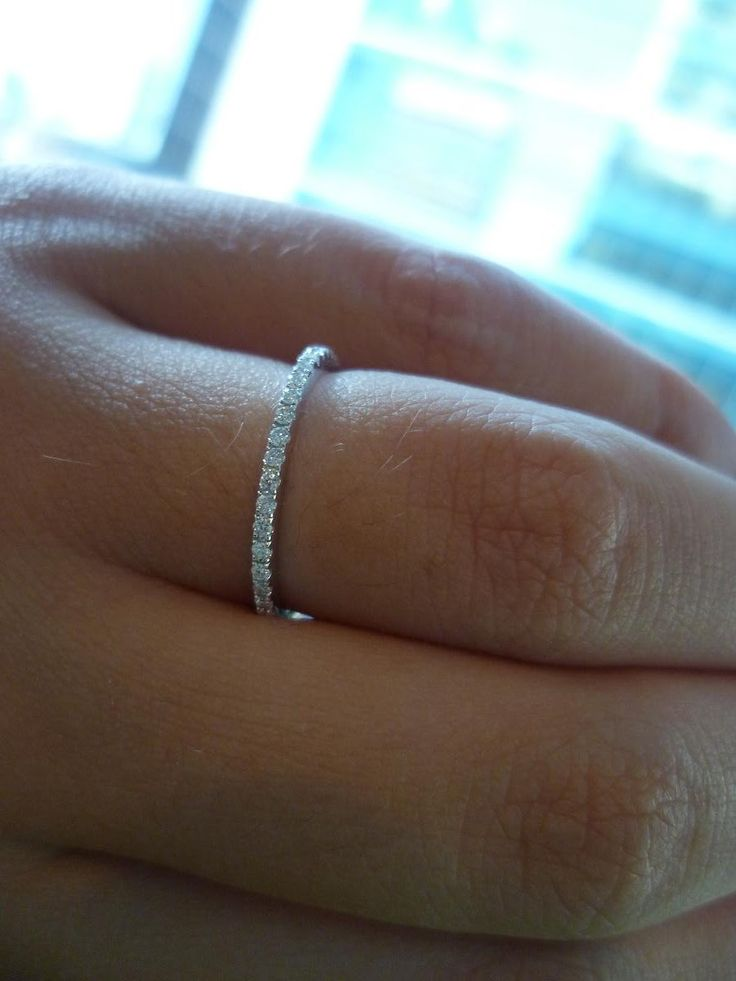 CHICKADEE'S WEDDING BAND:  size 4, thin (as thin as can be without losing sight of the stones; 1.6 mm?), low profile (does not bump up against the solitaire on e-ring), eternity band (for maximal brilliance, use moissanite instead of diamonds) that lines up well next to the e-ring.