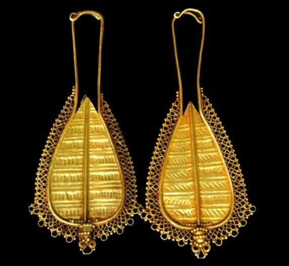 Nage people, Central Flores, probably 19th century, gold  Traditional earrings of the Nage people, in the form of leaves. They are tradition...