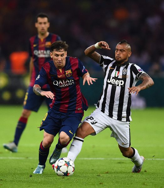 ionel Messi of Barcelona is tackled by Arturo Vidal of Juventus during the UEFA Champions League Final between Juventus and FC Barcelona at Olympiastadion on June 6, 2015 in Berlin, Germany.